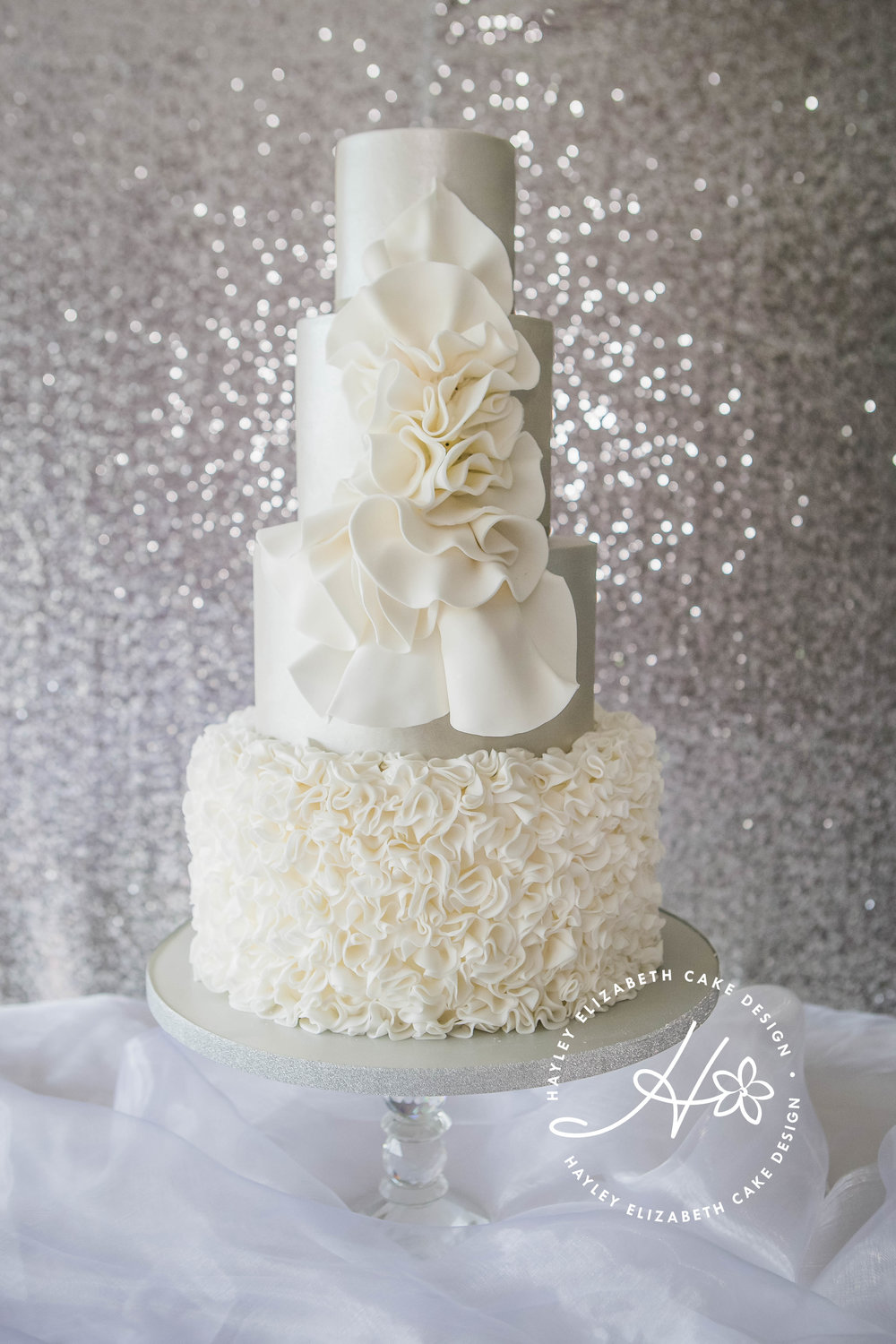 silver-shimmer-wedding-cake-with-large-white-ruffle-detailing.jpg