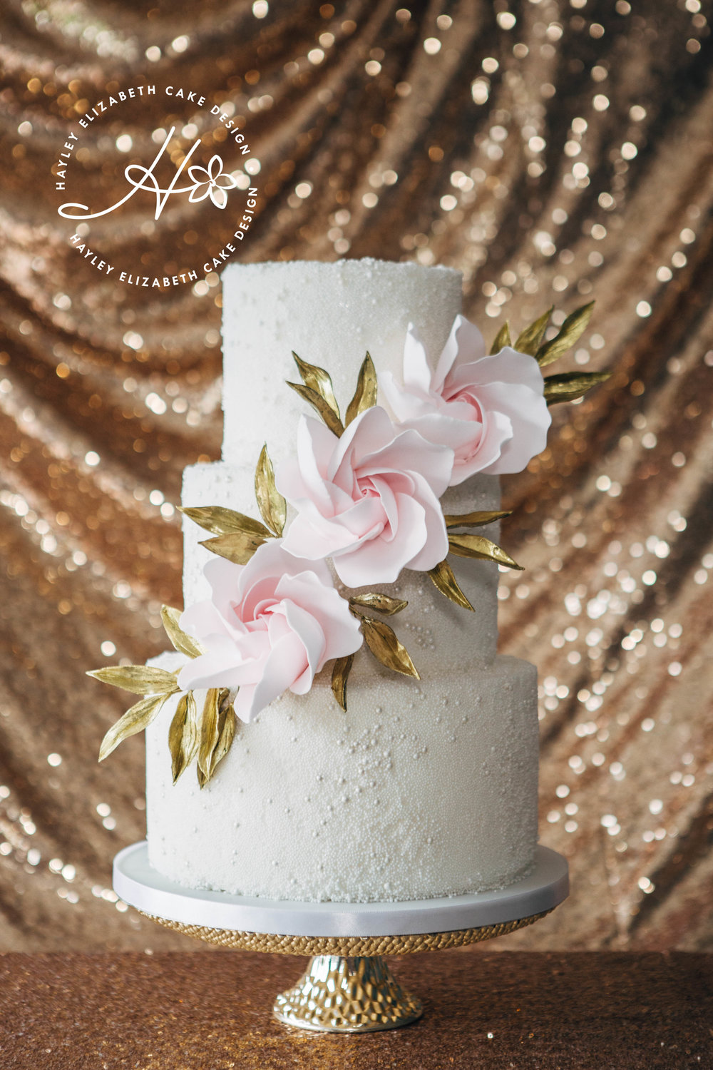 textured-wedding-cake-with-contemporary-roses-and-gold-leaves.jpg
