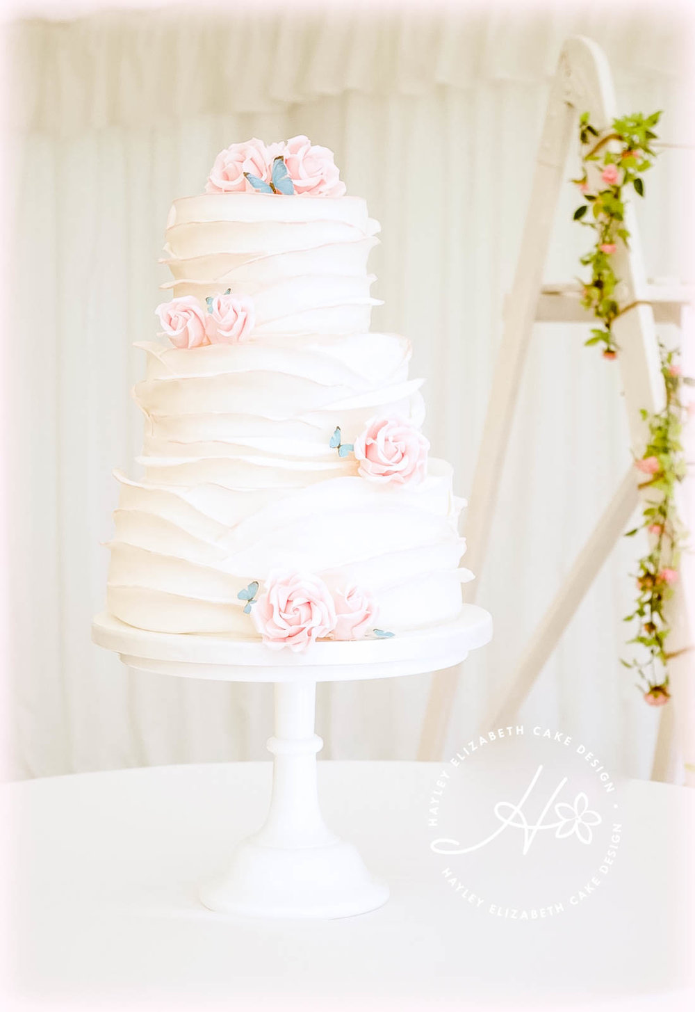 white-ruffle-wedding-cake-with-pink-painted-edge.jpg