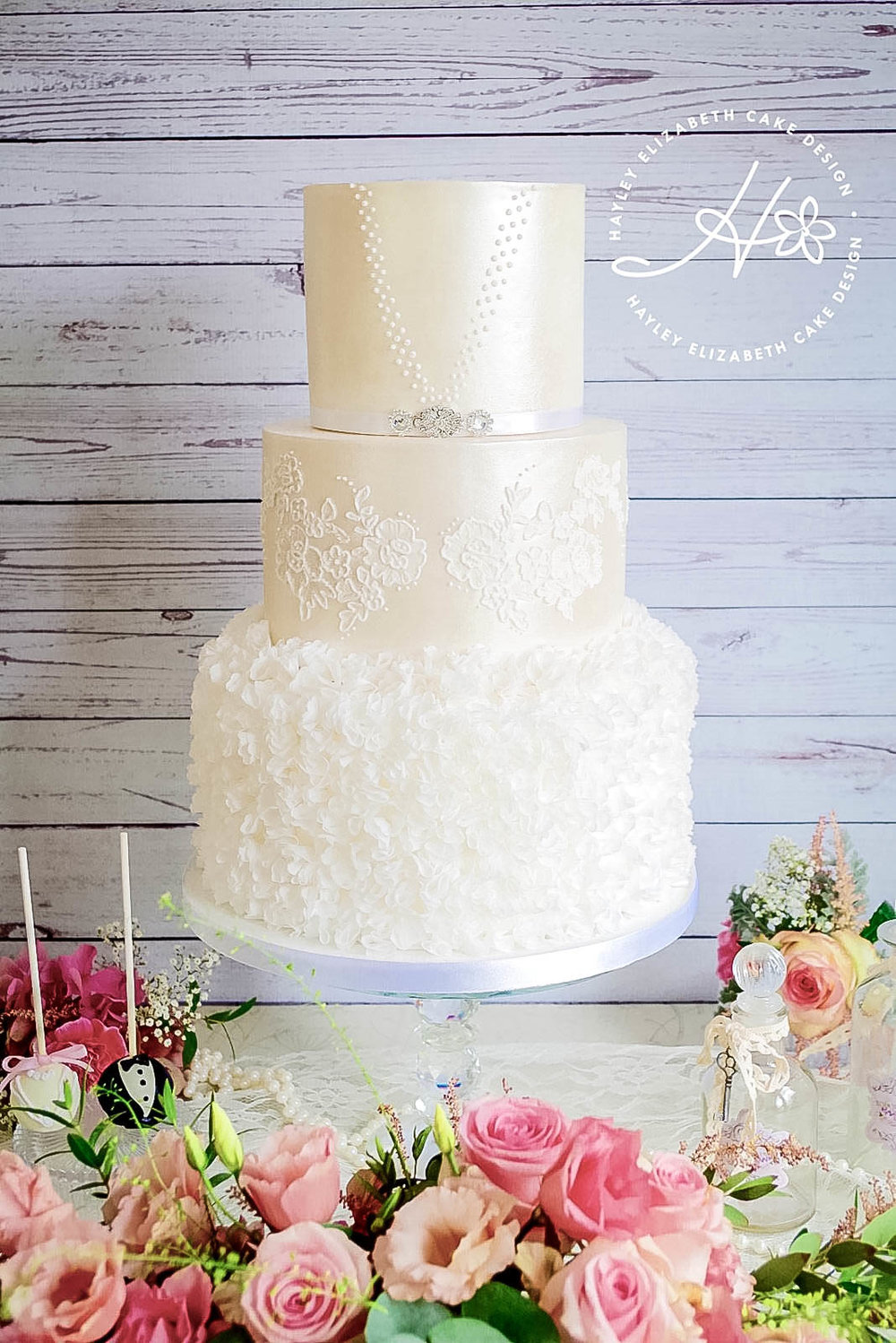 white-shimmer-wedding-cake-with-rice-paper.jpg