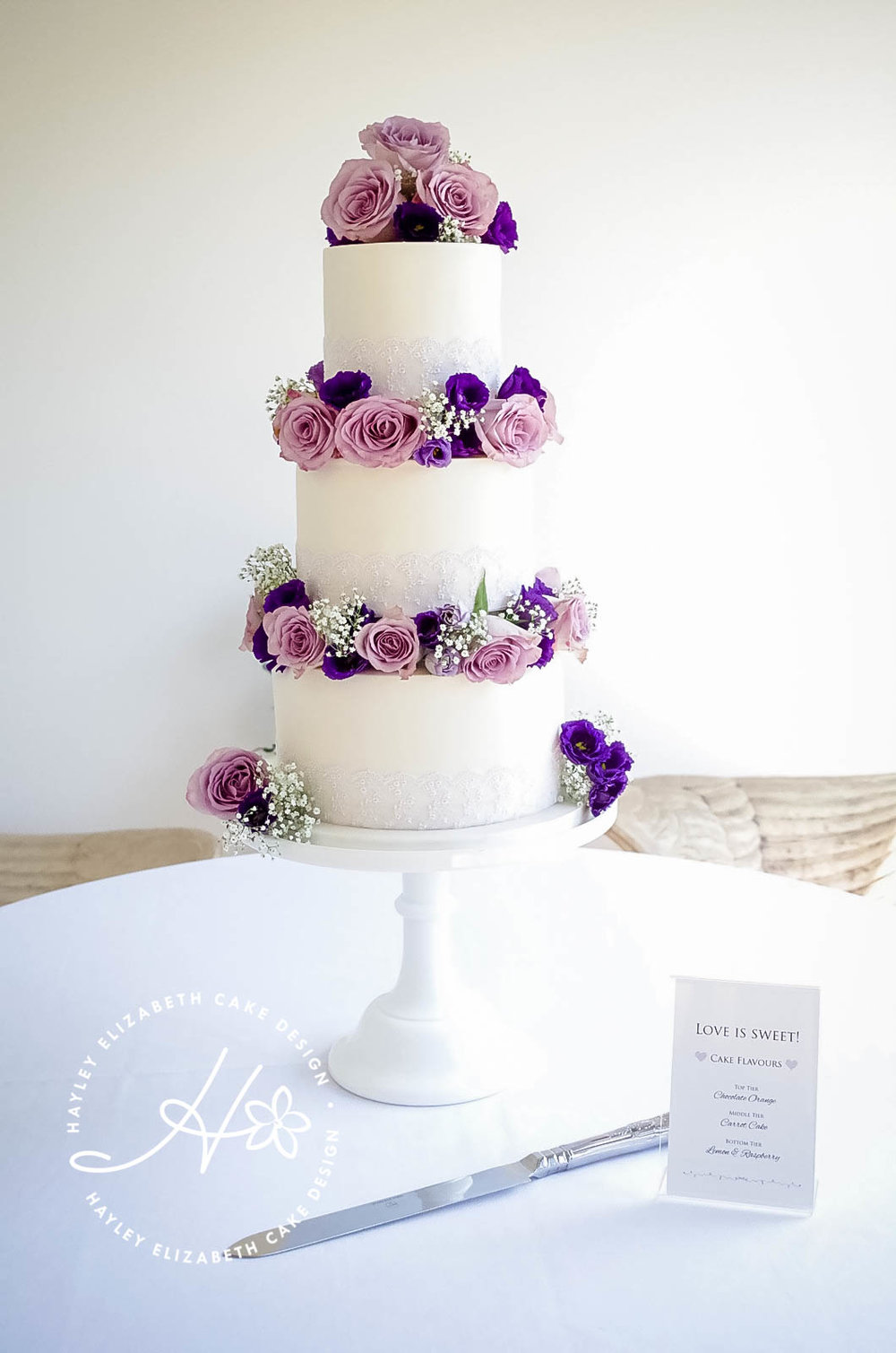 white-tiered-weddingcake-withfresh-flowers.jpg
