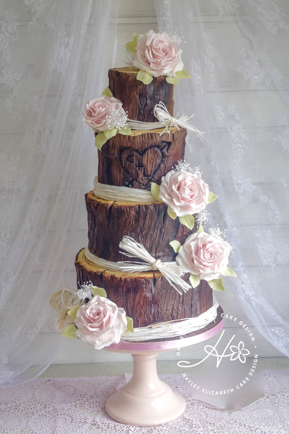 woodland-log-wedding-cake-with-roses.jpg
