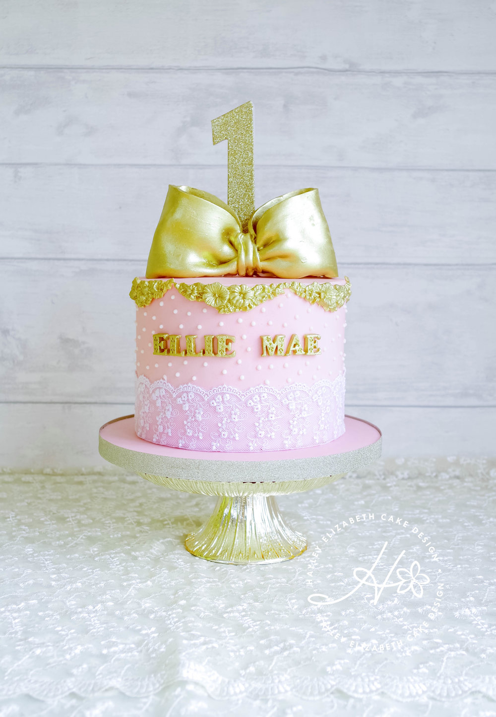 pink-and-gold-first-birthday-cake.jpg