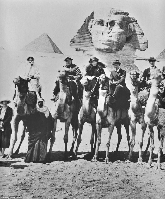 Winston Churchill at the Great Pyramids in Egypt in 1919, with T.E. Lawrence, second from the left. Churchill fell off his camel.