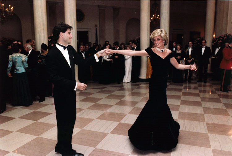In an iconic moment, Princess Diana dances with John Travolta at a formal reception at the White House.