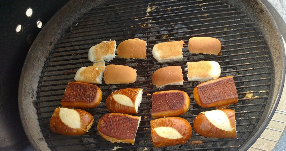 You HAVE to grill the buns.  Spray with olive oil, sprinkle with seasoning salt or garlic salt and set on the grill, don't leave them, they will toast fast.  Remove when they are toasted to perfection.