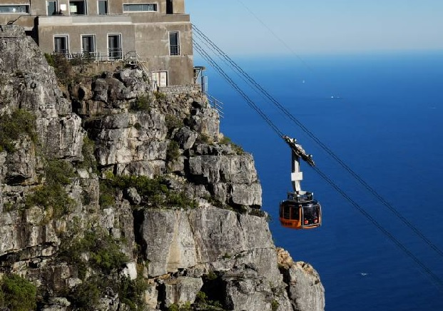 DAY 3:                    Table Mountain & Cape Town city tour - Drive through the 'Mother City' and see the Castle Good Hope, Houses of Parliament, Greenmarket square and other sites...Visit scenic Peninsula Area… take a picture from the Southwestern most point of Africa!Weather permitting, you can take the cable car to the top of Table Mountain