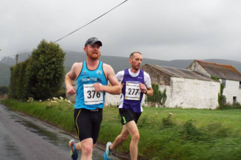 Aaron Meharg (Acorns AC) and Steven McAlary (Springwell RC) on their way to new club records
