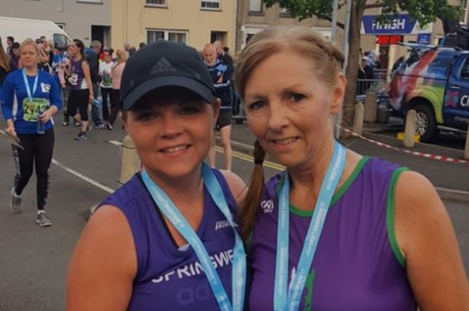 Kathy Donaghey (Springwell RC) with local runner Catherine Lavery (Scrabo Striders) at the Ards HM