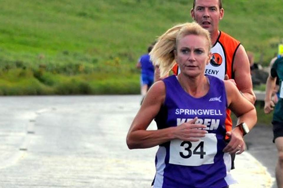 Springwell RC's Karen McLaughlin at the Portrush 5 Mile Road Race (Photo Richard McLaughlin)