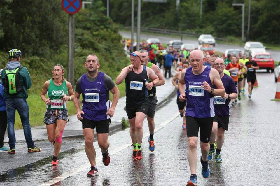 Springwell RC's Ricky Wilson and Jim O'Hara take on the Foyle Bridge at the Waterside Half Marathon.