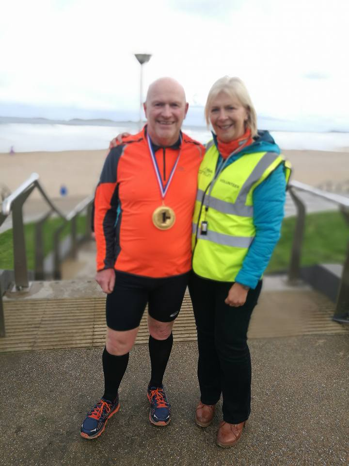 Mags Mathieson congratulates Kenneth Bacon on his 100th Parkrun.