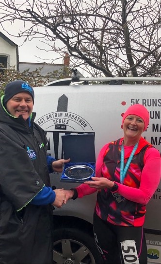 Springwell RC's Helena Dornan receives her first place award from EAMs organiser Peter Montgomery.