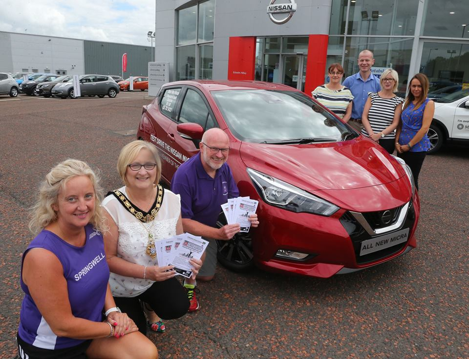 The Mayor of Causeway Coast and Glens Council, Councillor Brenda Chivers along with Amanda Scott and Kenneth Bacon from Springwell RC at the launch of the Edwin May Nissan 5 Mile Classic