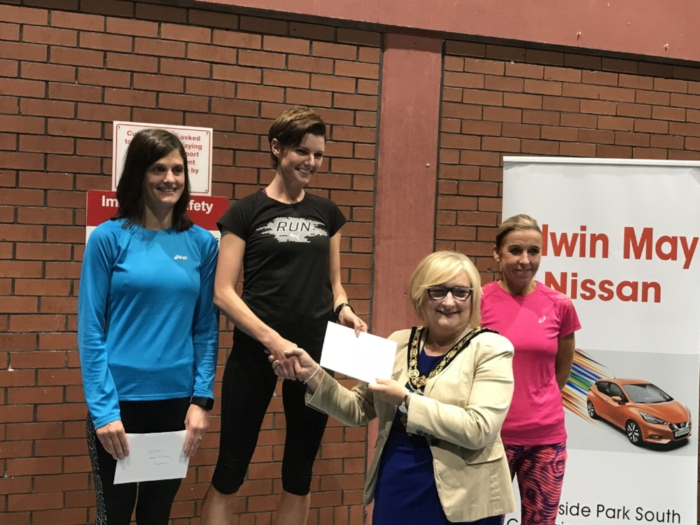 Gemma McDonald (Ballycastle Runners), Ciara Toner (Springwell RC) and Cathy McCourt (Unattached) with Mayor Brenda Chivers