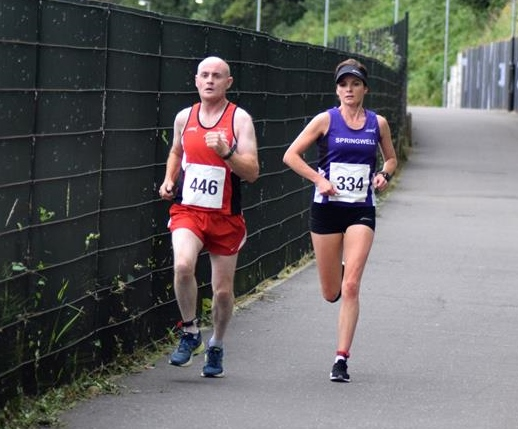 James Crampsey (COD Spartans) & Ciara Toner (Springwell RC) at Dessies 10k  (Photo Local Derry Sport)