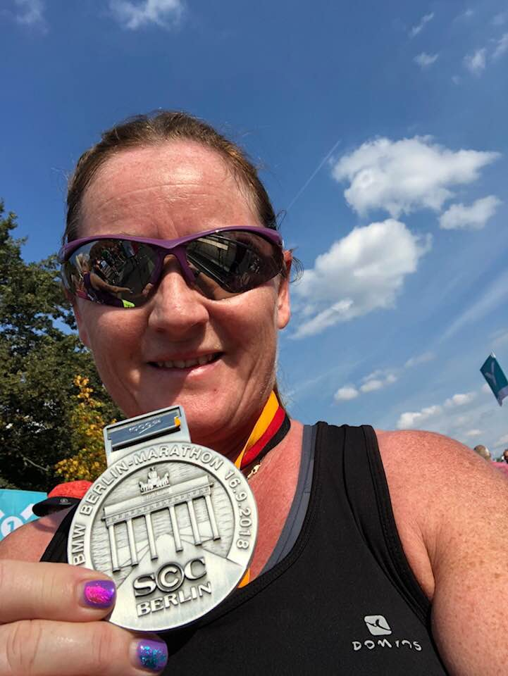 Springwell RC's Alison McAllister with her finishers medal at the Berlin Marathon