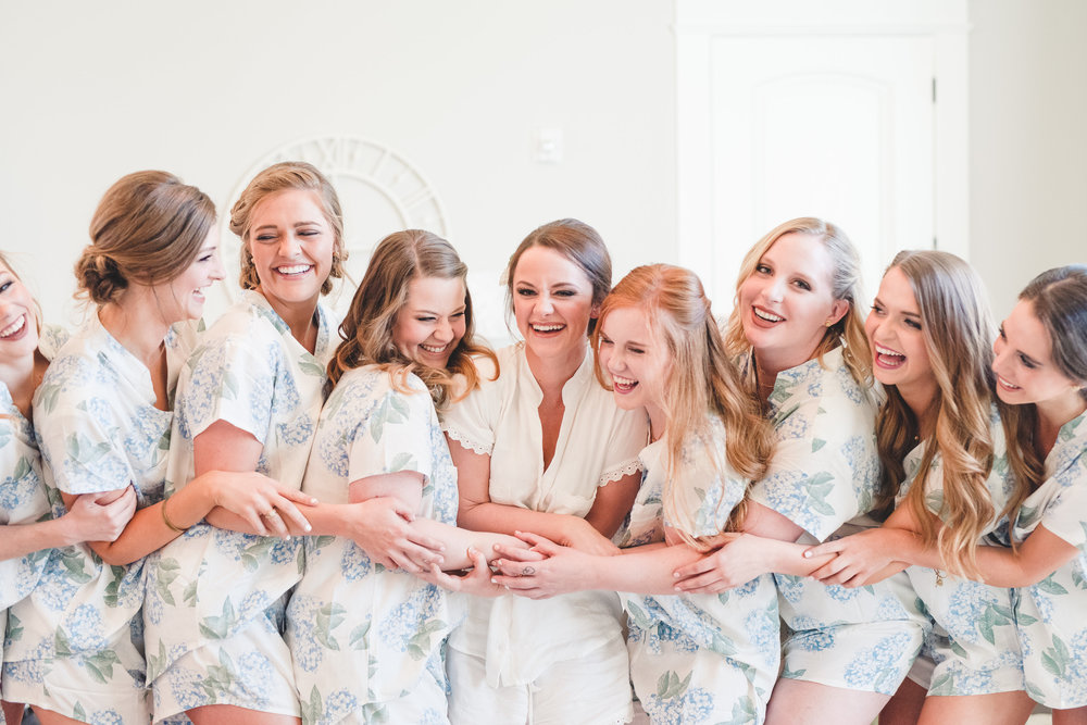 Bridesmaids matching robes | Rose Gold and Dusty Blue Winter Wedding in Dallas, TX