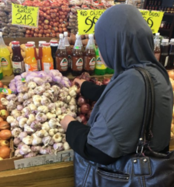 Afeefa shopping at the local Orange Farmers Market for ingredients to use in Sanctuary Kitchen Cooking Classes.