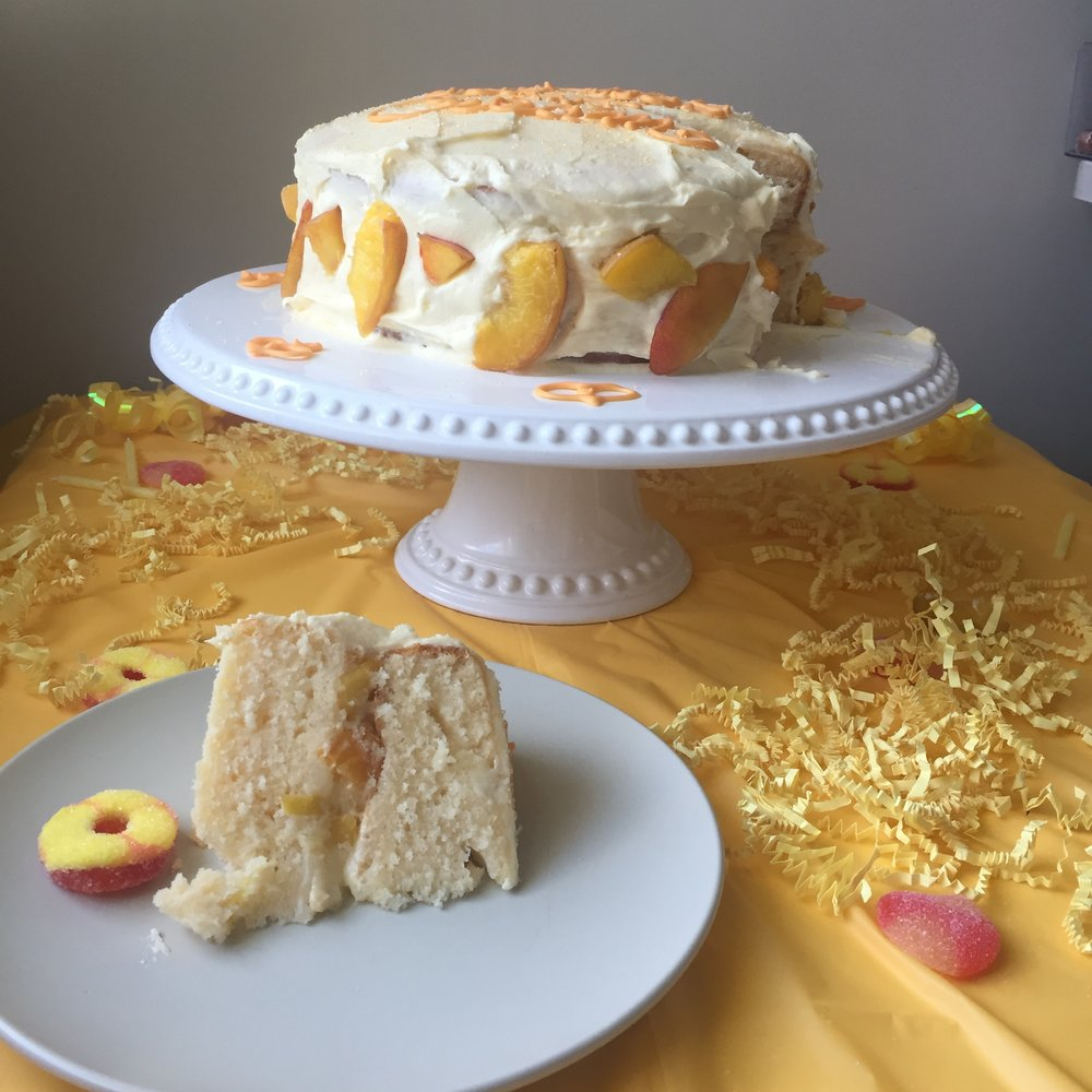 Cream Filled Champagne Cake with Peach Buttercream Frosting