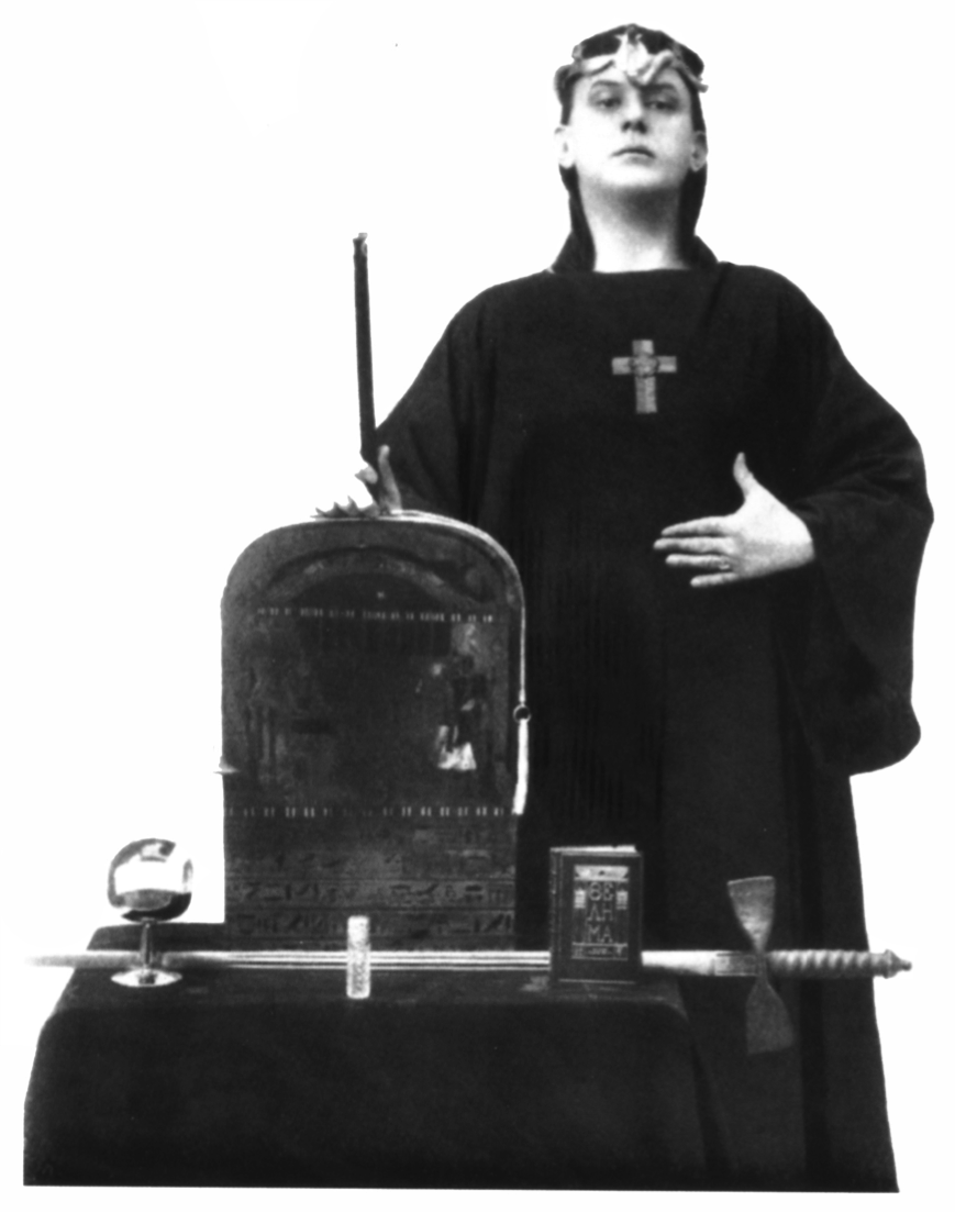 The Magician Aleister Crowley posing with the tools of his art