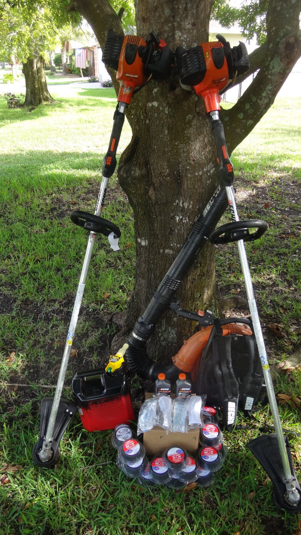 Pro Yard Tools - Two professional weed eaters, and a backpack blower.   Also a gas can, oil, eye protection, and a lifetime supply of trimmer line.