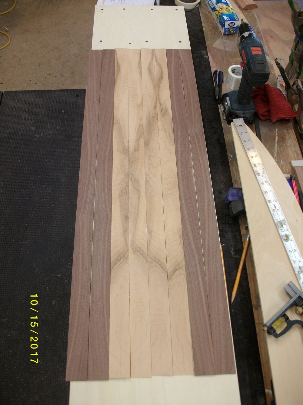 First the lams, some walnut tapers for the core and some ambrosia curly maple veneers.