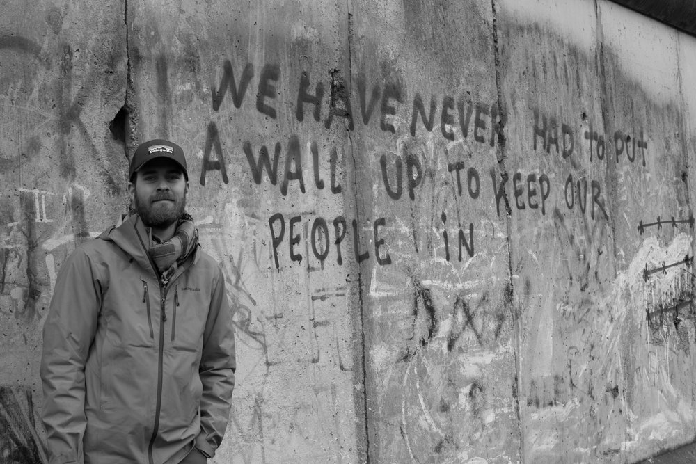 Nolan in front of the Berlin Wall