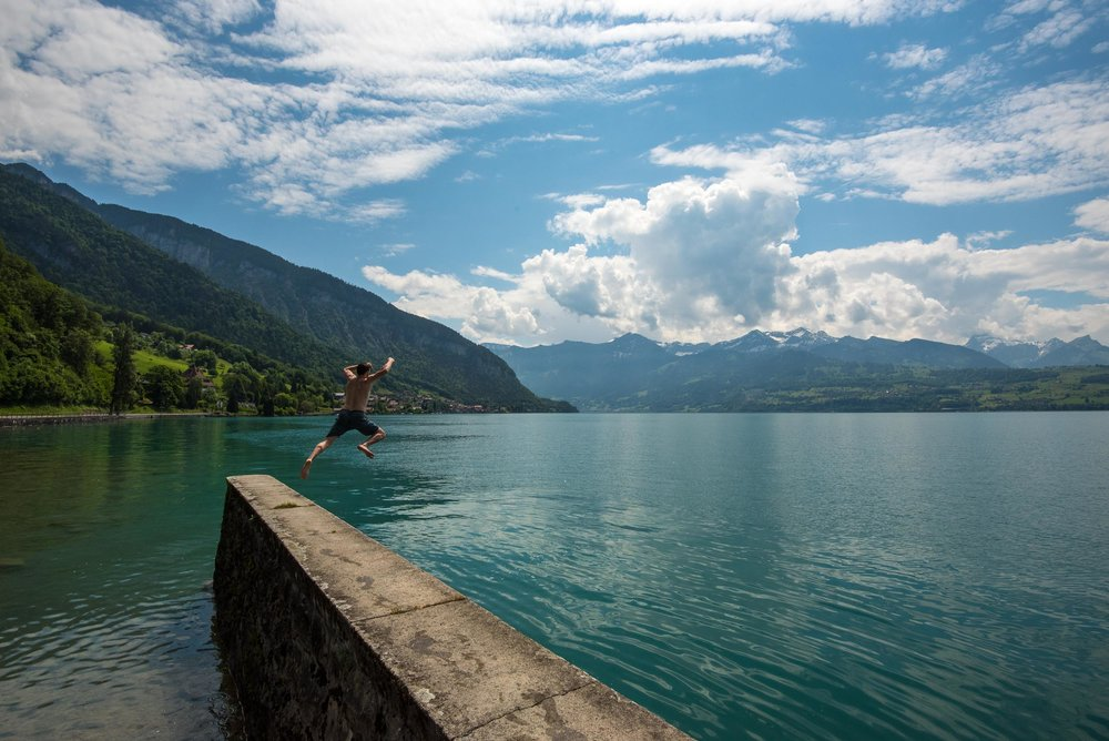 Nolan jumping in Lake Thun