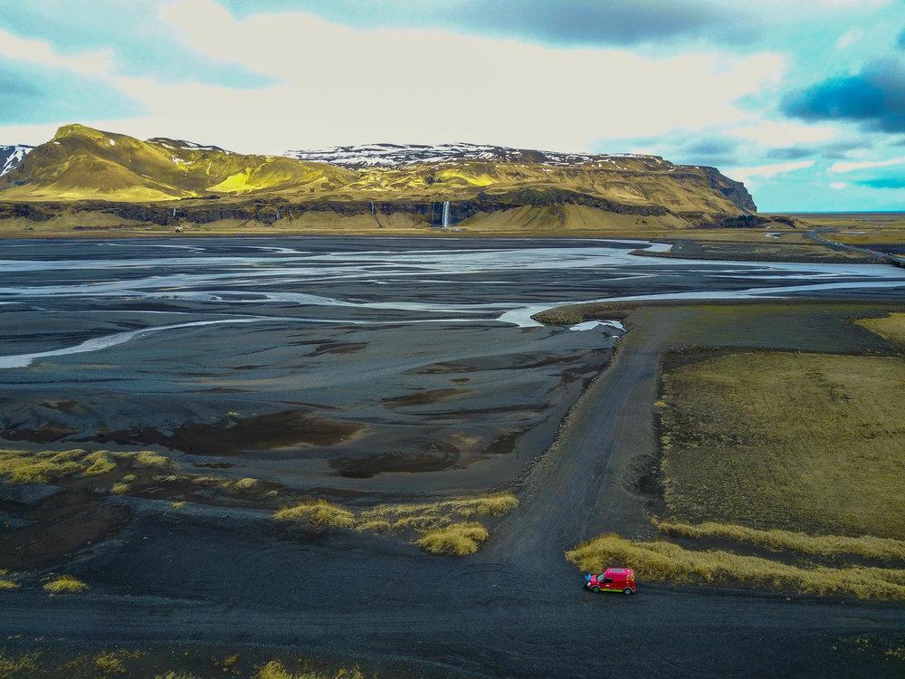 Black sand lagoons and Sejalandsfoss