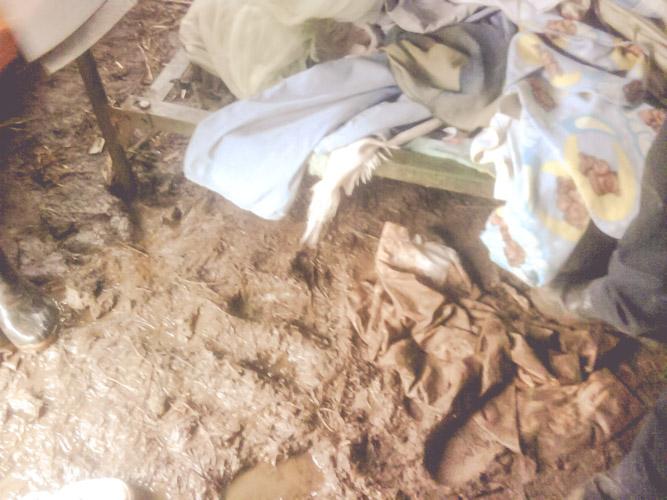 muddy-floor-inside-home-rain-cristo-rey-bed-new-life-nicaragua