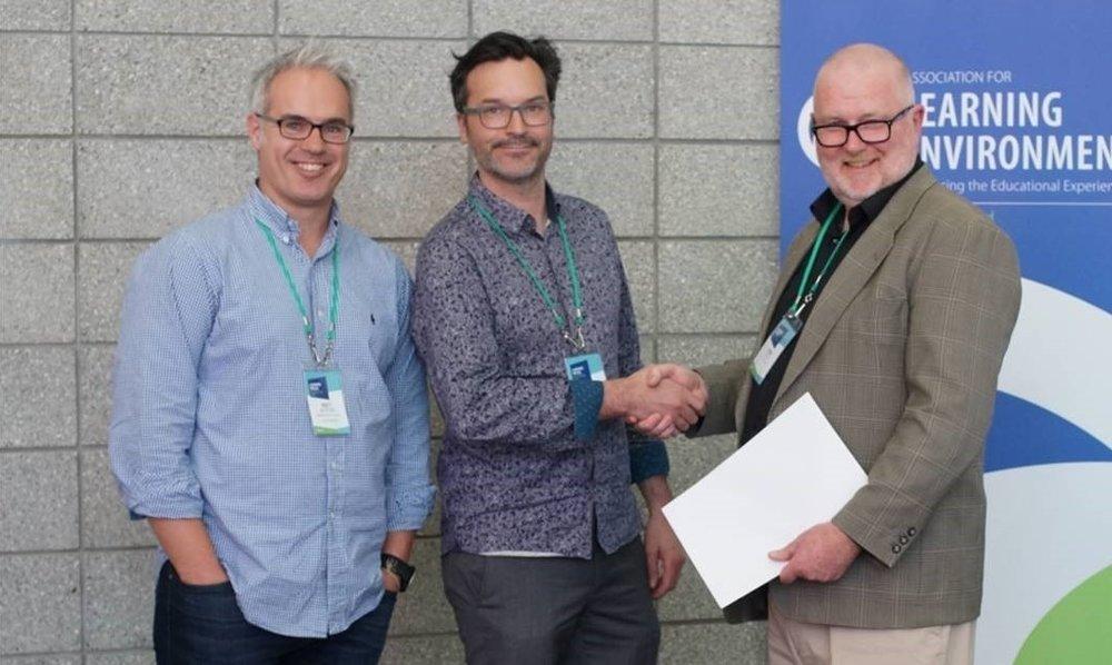 McKenzie Higham Architects' Matt Jeffery and Mark McMillan accepting the award.