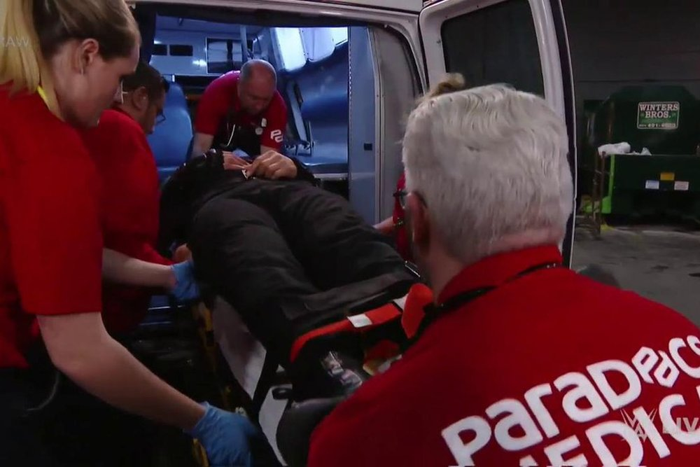 ParaDocs crew loads injured WWE Superstar Roman Reigns into an ambulance.
