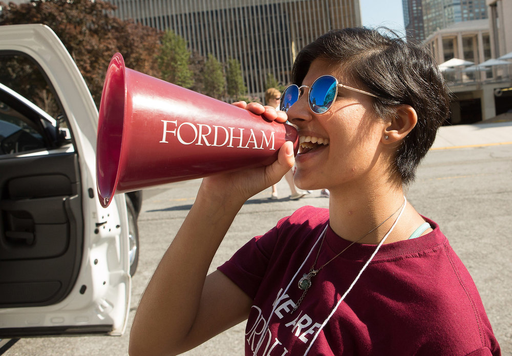 Fordham student cheers on classmates