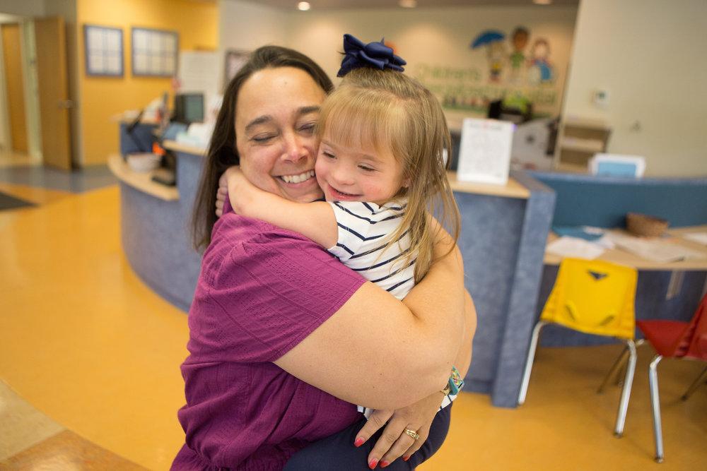 therapist hugs a patient