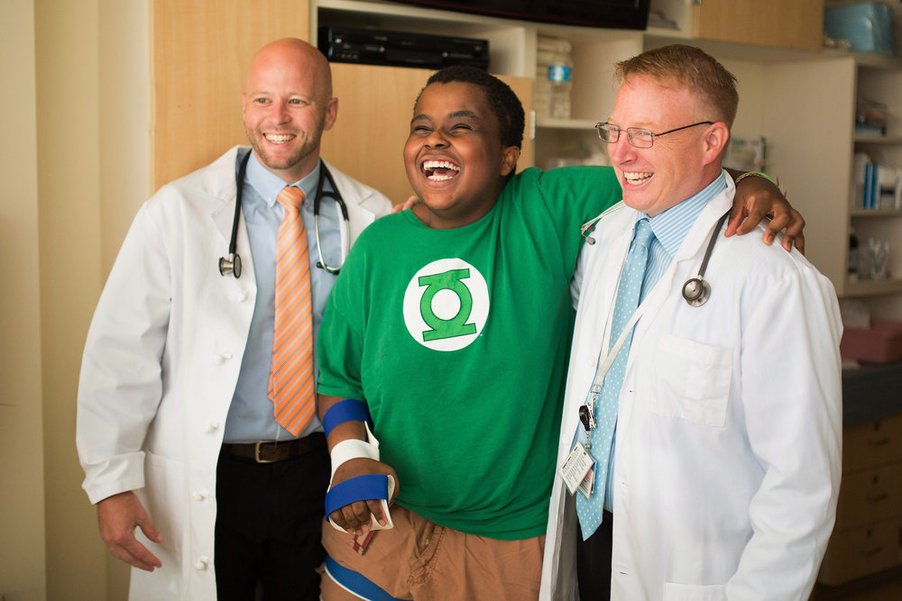 Doctors with a happy patient