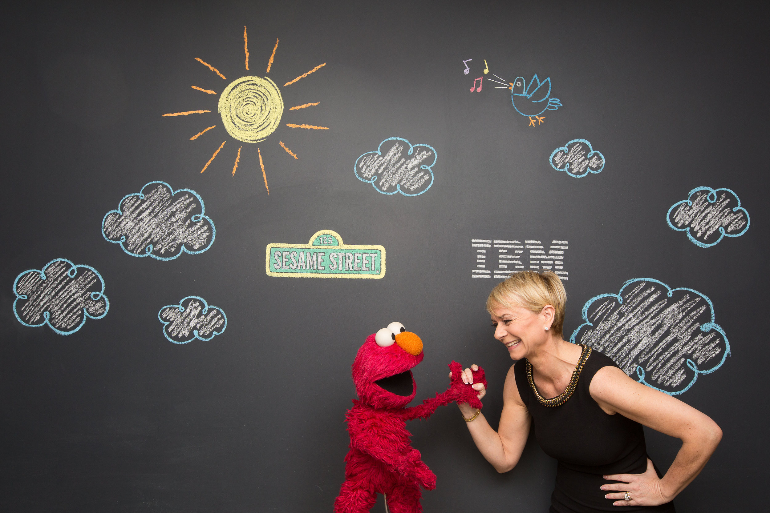Corporate portrait of Elmo with an IBM executive