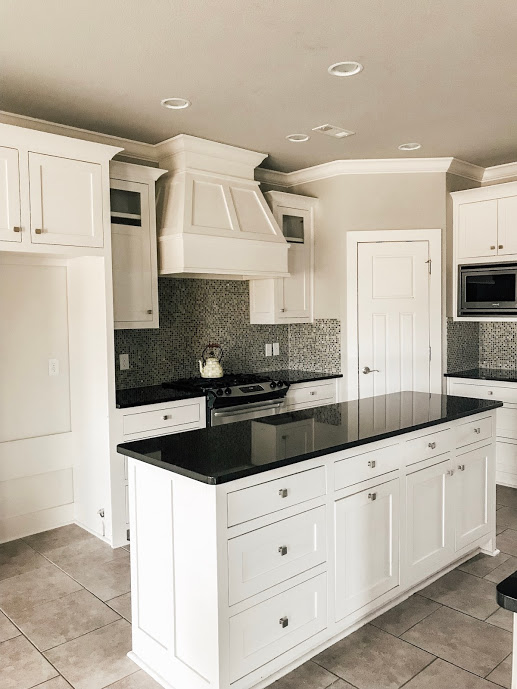 We love the solid wood white shaker cabinets with inset drawers and doors. We envision subway tile backsplash, new polished nickel hardware and maybe a rug to cozy up the space.