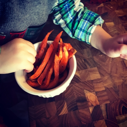 "Actual live footage of my son taking the sweet potato fries that I was photographing for this post. He said, ""Hey! Momma! Those are my fries!"" :) Can't argue with a kid that steals veggies!"