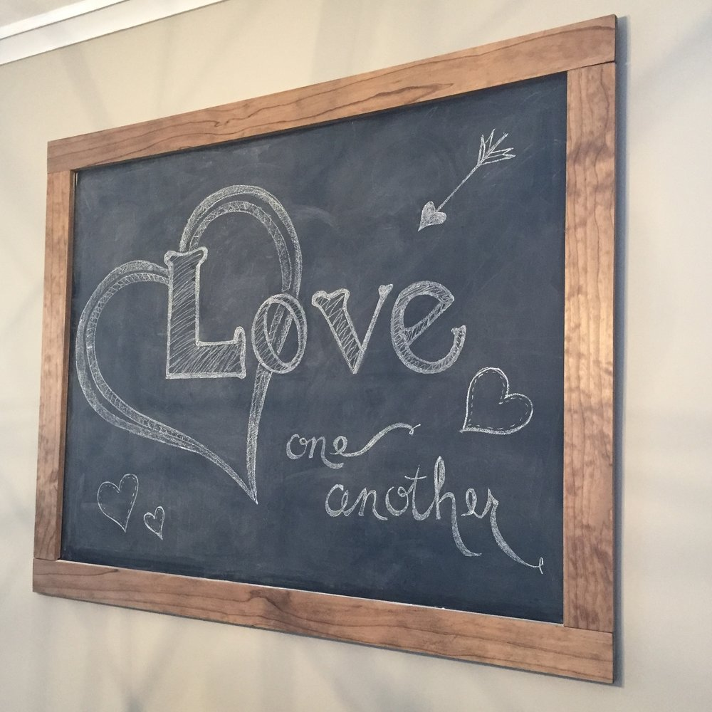 This large chalkboard was a quick DIY project. It's an affordable option to fill a large space with changeable art.