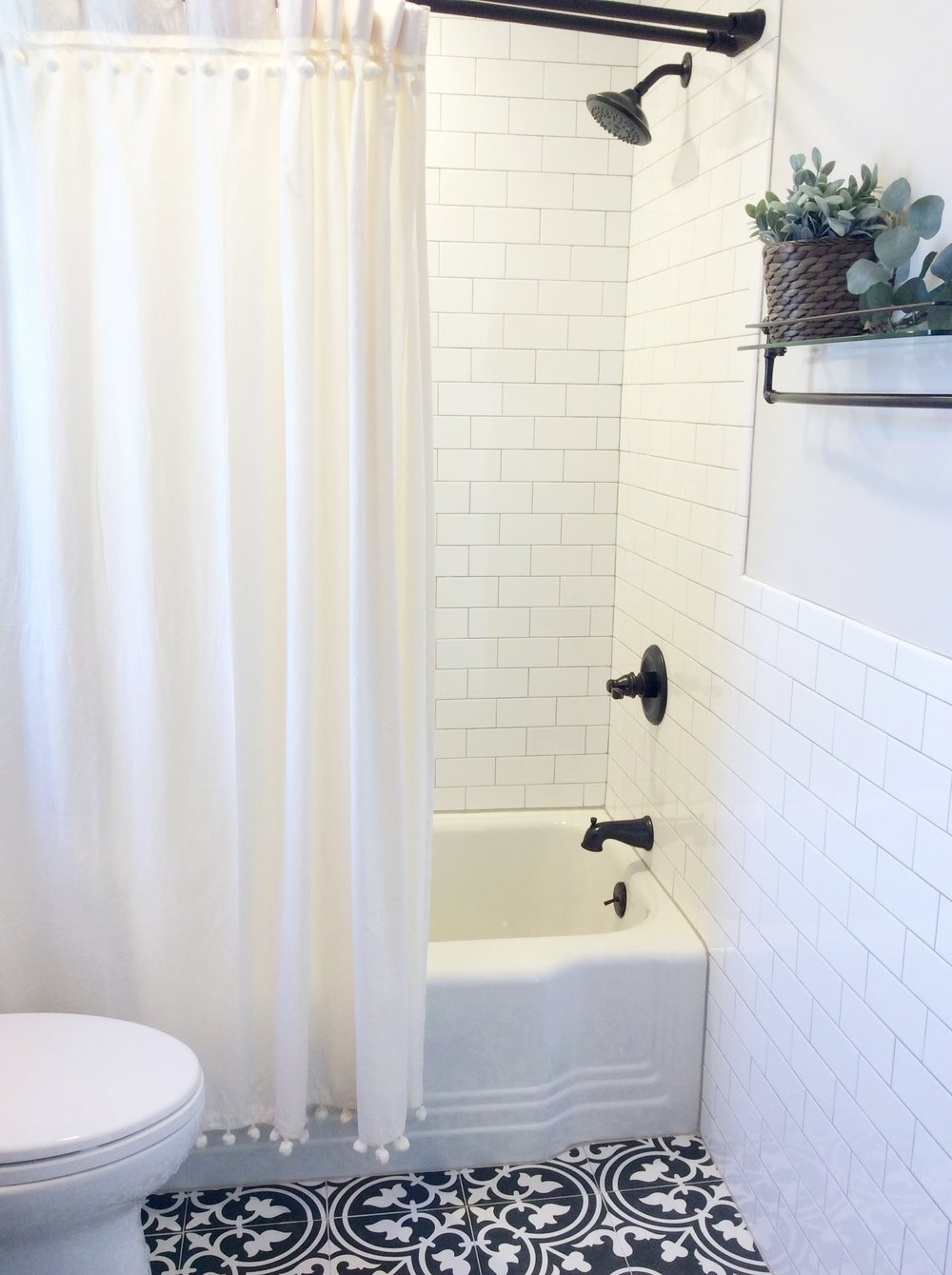 Fresh Farmhouse Style Bath. Black, White and Wood Bathroom. Shower Curtain: Urban Outfitters, Kohler Oil Rubbed Bronze Fixtures, Toto toilet, Somertile floor, Oyster Gray grout, originial design by beam&bloom