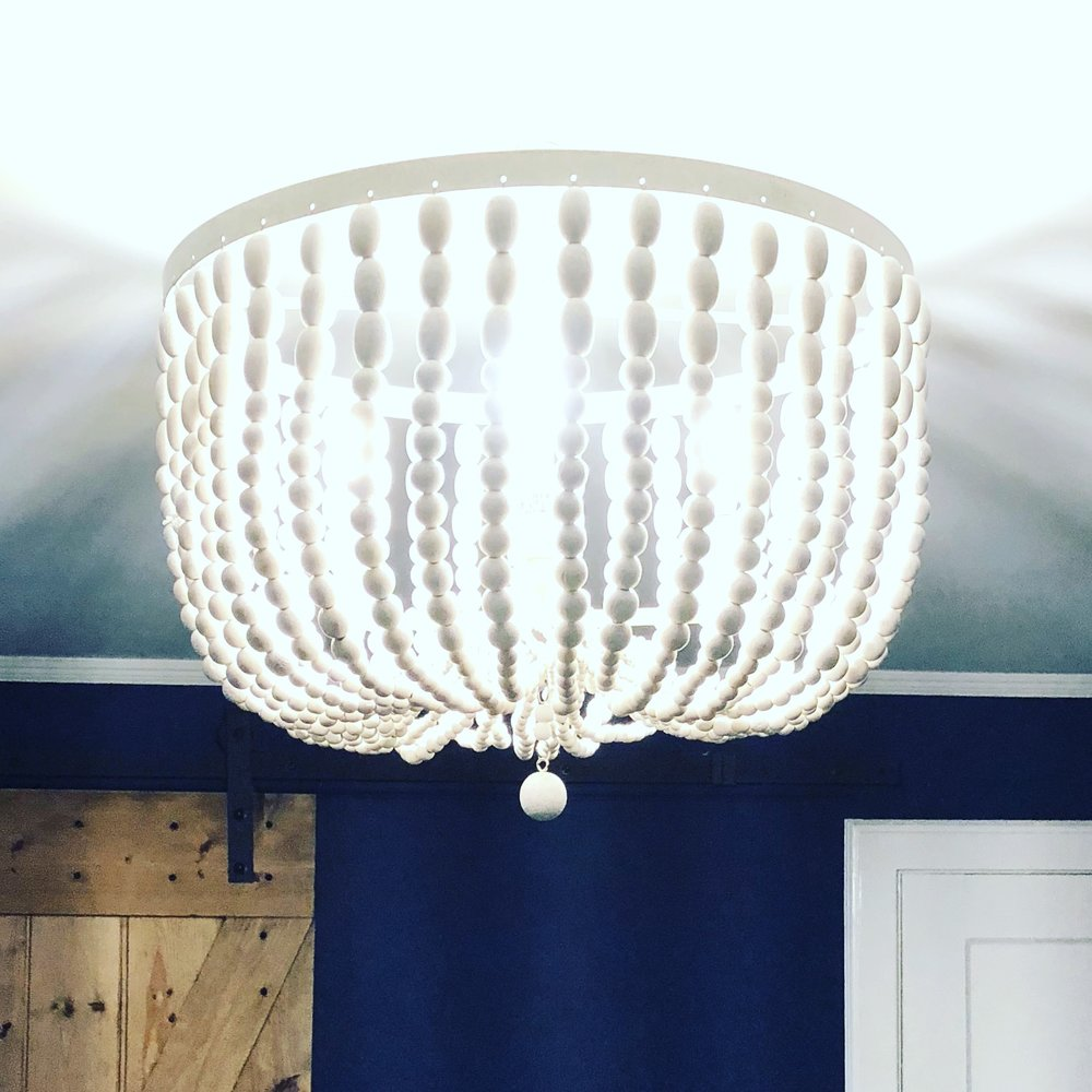 World Market Stunner. Farmhouse  style with a boho flair. White wood bead chandelier.   https://www.worldmarket.com/product/large-antique-whitewash-wood-bead-chandelier.do?sortby=ourPicks