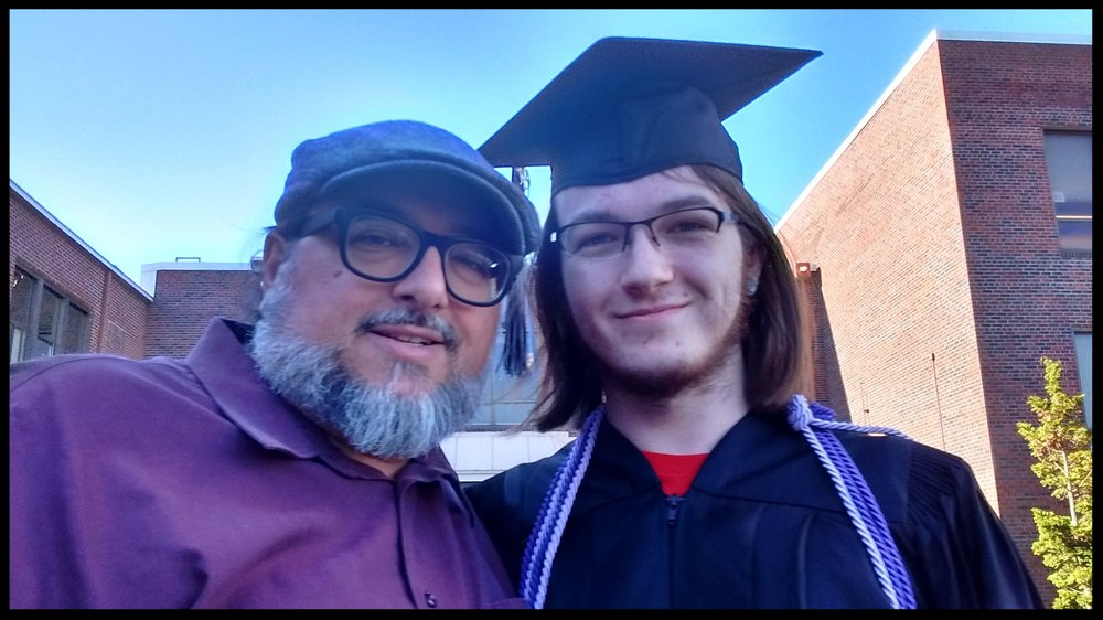 Christopher with his son, Angelo, at his high school graduation