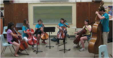 Students learning from the Meadowlark Quartet.