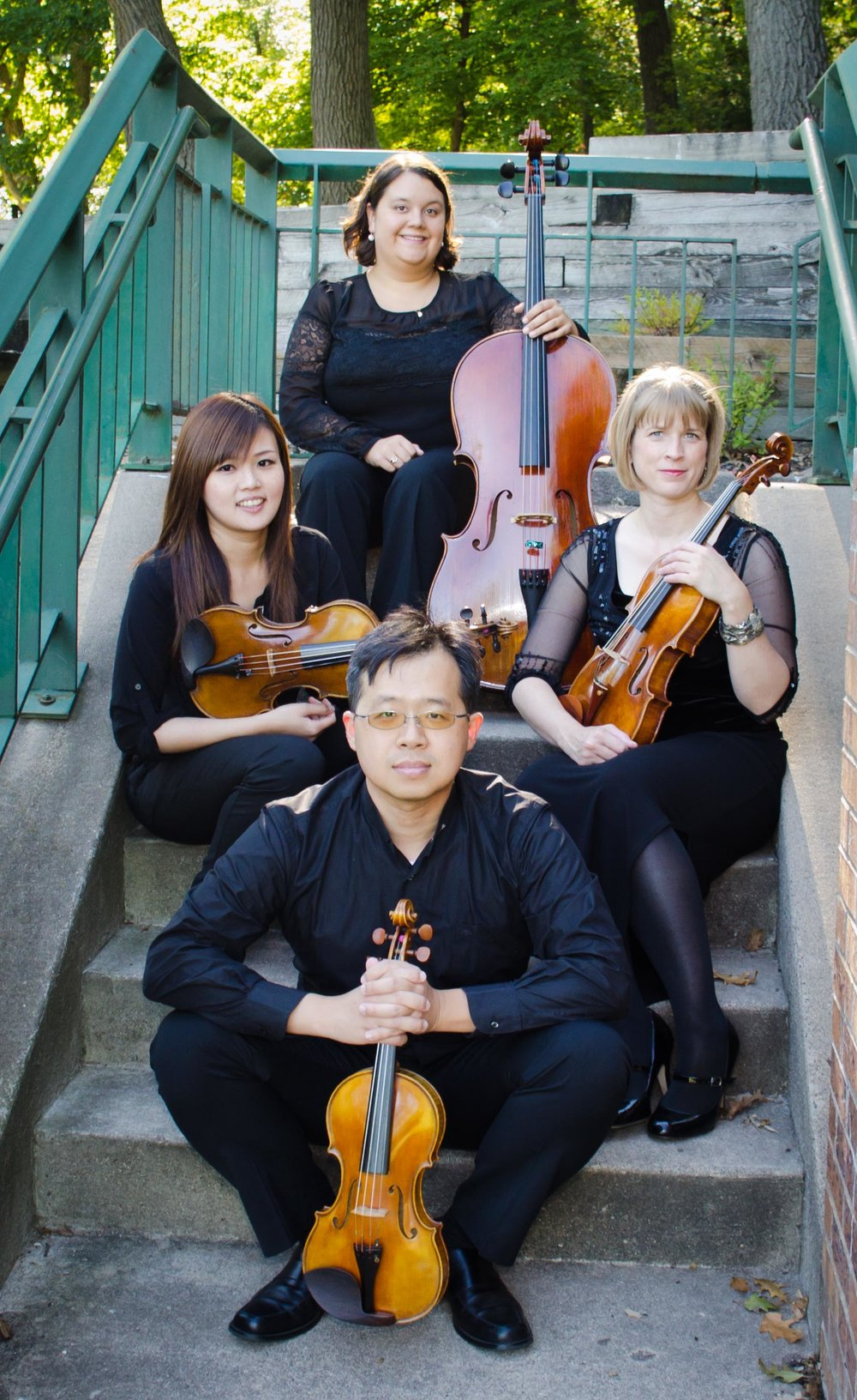 Meadowlark String Quartet: Hsin-Yin (Cindy) Min,  violin;  Te-Chiang (Bacco) Liu,  violin;  Kelsey Farr,  viola (not pictured);  Lindsay Schlemmer,  cello