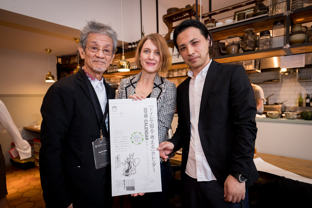 Japanese Prestigious Graphic Designer Mr. Masaki Zaitsu and the Calendar He Designed with ADP Regional President Annie Ivanova and ADP Japanese Member Representative Hajime Tsuruta (Left to Right) .jpg