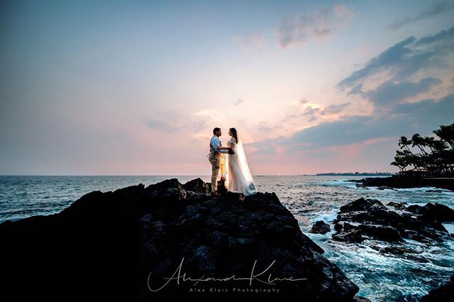 Ok so she climbed this rock in high heels with no worries and hesitation!! That's my couple straight up charging it up those rocks ike 15 feet  high!  Oh yeah that's not normal rocks that's lava rocks!! Cheers to adventure and lasting love!  Venue/Coordination: @royalkonaresort  Videography @walczukproductions @domwalczuk • . #hawaii #sunsetwedding  #hawaiiphotographer #bigislandweddingphotographer #hawaiiweddingphotographer ##weddingday#weddingmoments #weddingceremony #weddingstyle#weddingfashion #bridalfashion#weddinginspirations #weddingdetails #ig_oahu #weddingideas#weddinginspo #hiweddings #teamnikon #portrait