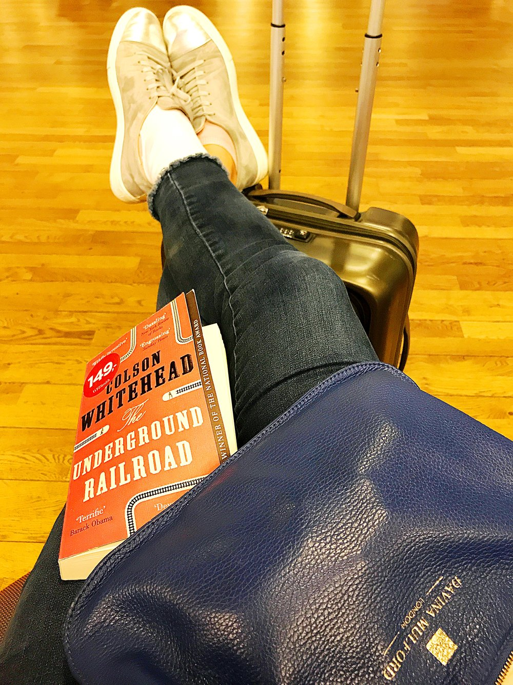 My view:  new book , favourite go everywhere  bag  (and sore ankle from Danish cobble stones).