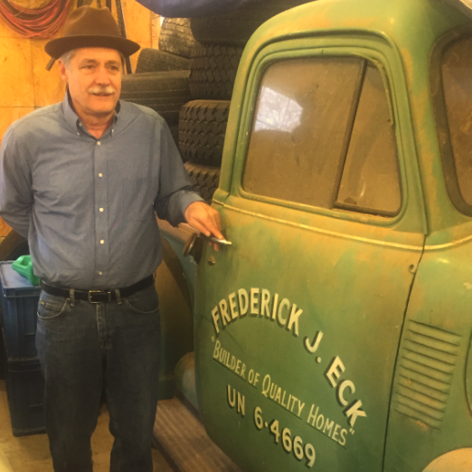 Jim Eck, P.E. VP of Engineering , standing in front of his dad's 1951 Chevy work truck; home building is a long standing Eck family tradition.