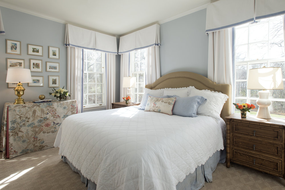 Light blue and white bedroom